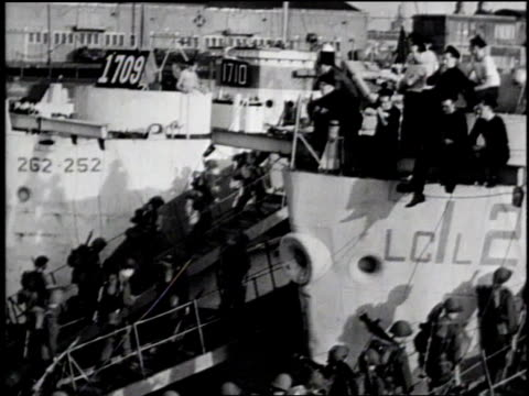 soldiers boarding ships for d-day invasion / england - 1944 stock videos & royalty-free footage