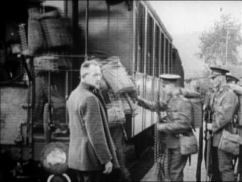 us soldiers boarding train / germany / newsreel - 1920 1929 stock-videos und b-roll-filmmaterial