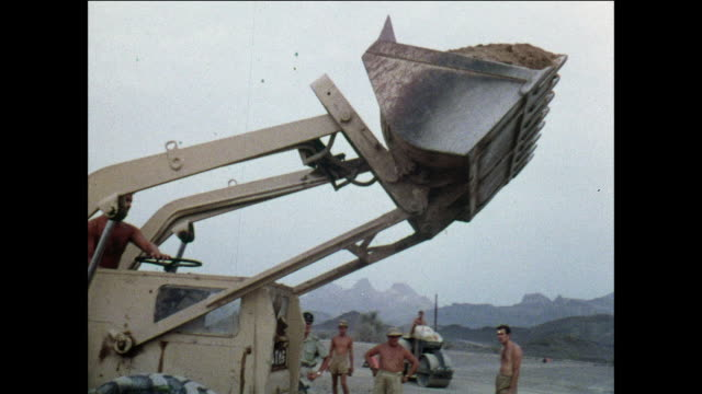 montage soldiers build a helicopter landing pad in the mountains / aden, yemen - bulldozer stock videos and b-roll footage