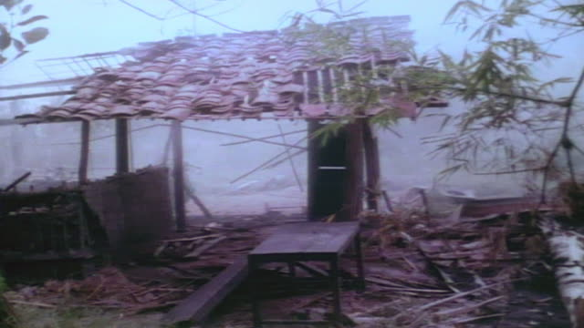 soldiers bulldozing captured viet cong village into ruins / vietnam - army soldier stock videos & royalty-free footage