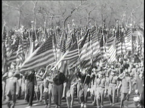 soldiers carry american flags during a parade - patriotism stock videos & royalty-free footage