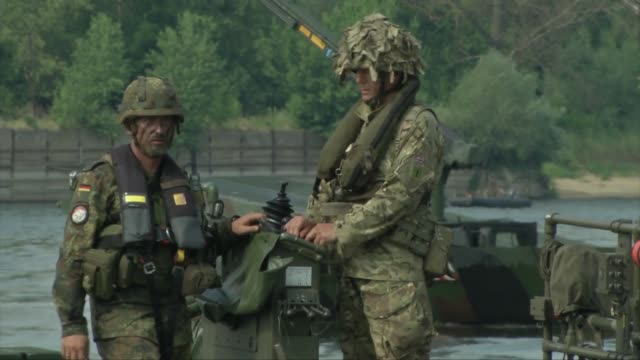 soldiers carry out a river crossing with german and british military - british military stock videos & royalty-free footage