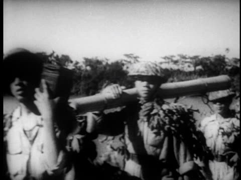 soldiers carry weapons and march through countryside along road / carrying food and supplies up into the mountains - north vietnam stock videos and b-roll footage
