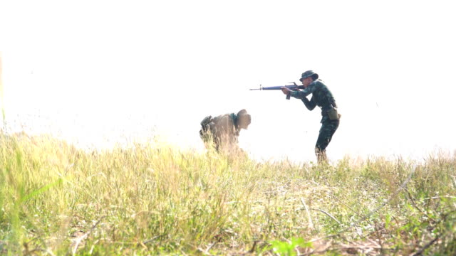 Soldiers Carrying Injured his friend among meadow