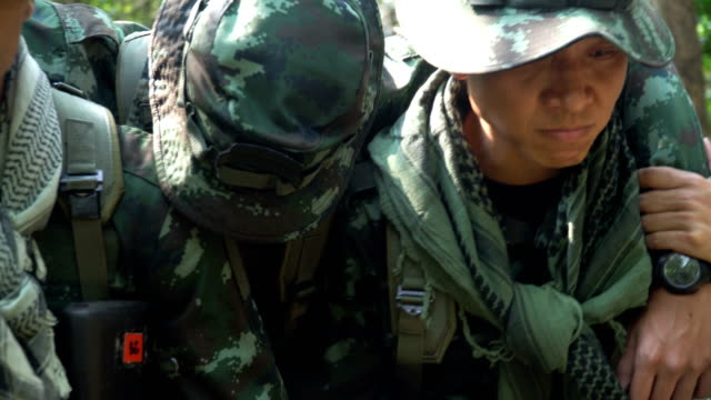 Soldiers Carrying Injured his friend  in the tropical forest