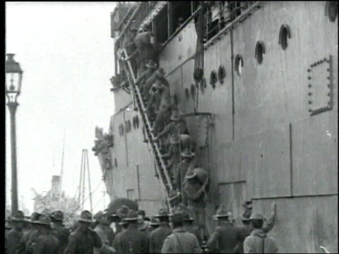 soldiers carrying rations disembark from large ship / france - 1918 stock videos & royalty-free footage