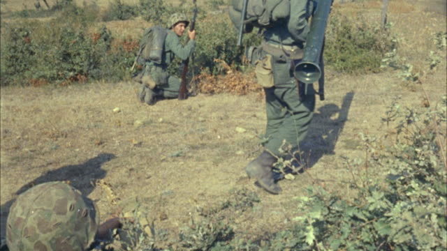 1967 ms soldiers carrying rocket launcher sneaking in bushes - rocket launcher stock videos & royalty-free footage