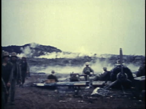 soldiers carrying supplies near airplane crash / iwo jima japan - schlacht um iwojima stock-videos und b-roll-filmmaterial