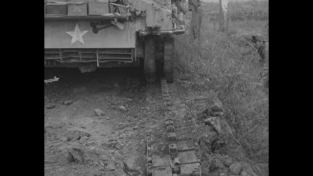 us soldiers climbing up hill in fog / soldiers standing around open field tank nearby / soldier walking next to damaged tank sitting on road / close... - land mine stock videos and b-roll footage