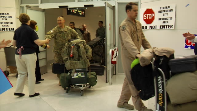 soldiers come home from iraq and afghanistan at bwi airport on march 03 2012 in baltimore md - war veteran stock videos & royalty-free footage
