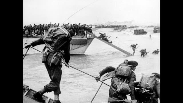 / soldiers coming ashore during d-day / ships in the distance. d-day soldiers come ashore on june 06, 1944 in france - d day stock videos & royalty-free footage