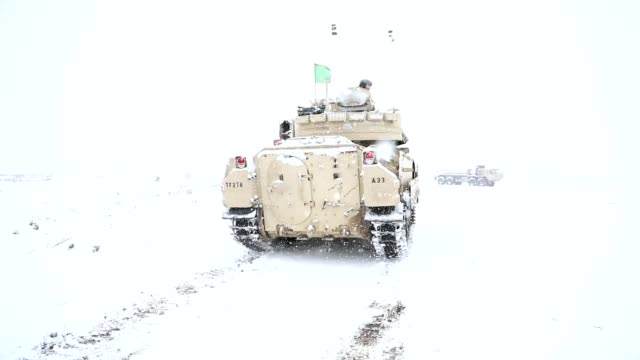 Soldiers conduct winter live fire exercise in Poland during Operation Raider Lightning