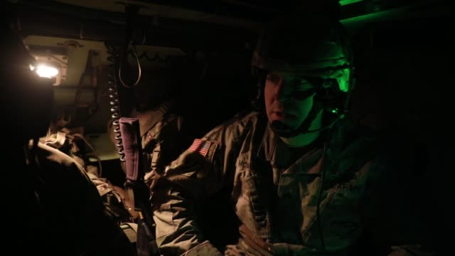 soldiers conduct winter live fire exercise in poland during operation raider lightning. - kampfpanzer stock-videos und b-roll-filmmaterial
