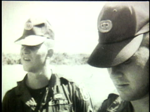 us soldiers conferring and studying map during the early escalation of the vietnam war / south vietnam - south vietnam stock videos & royalty-free footage
