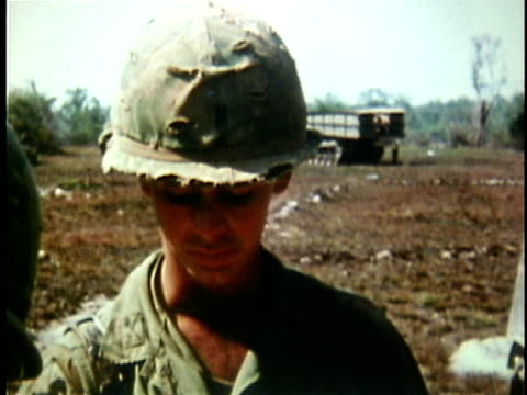 us soldiers conferring on map and mpving out from landing zone / cambodia - cambodia stock videos & royalty-free footage
