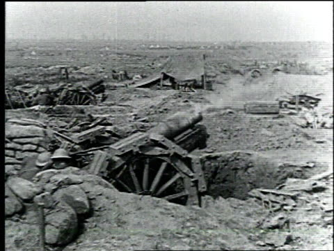 wwi soldiers continuously fire cannons along the front lines of battle / france - anno 1918 video stock e b–roll