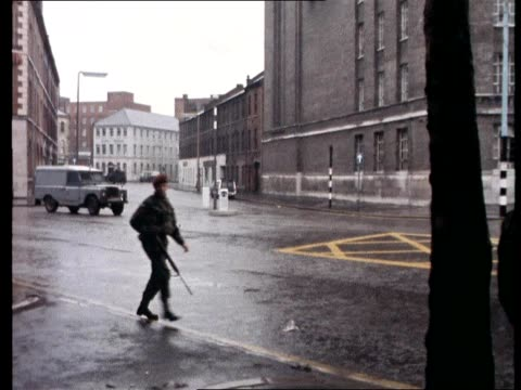 soldiers cordon off the offices of the bbc in belfast as a car bomb explodes outside the building - belfast stock videos & royalty-free footage