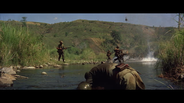 ws soldiers crossing stream on run for cover - 歩兵点の映像素材/bロール