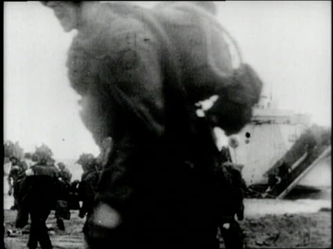 soldiers crowd into a landing craft on d-day and land on normandy beaches as the wounded are carried by their fellow soldiers. - d day stock videos & royalty-free footage