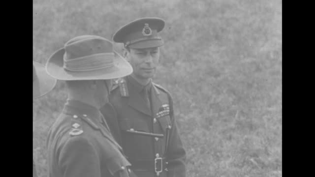 soldiers dig trenches for home defense in england / george vi, wearing uniform of the british army, standing with new zealand officers, looks at... - bayonet stock videos & royalty-free footage