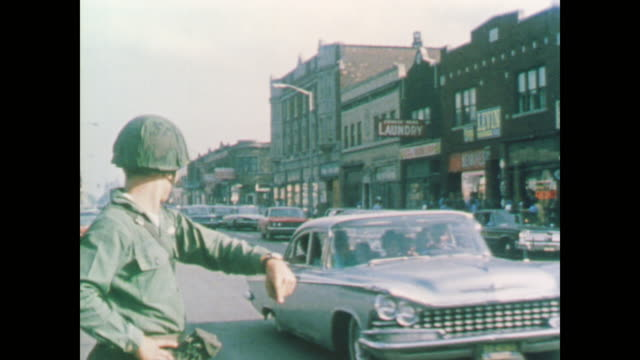 soldiers direct traffic past destroyed buildings - 1967 bildbanksvideor och videomaterial från bakom kulisserna