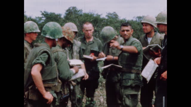 soldiers discuss plans during vietnam war in 1968. sequence of shots. - vietnam war stock videos & royalty-free footage