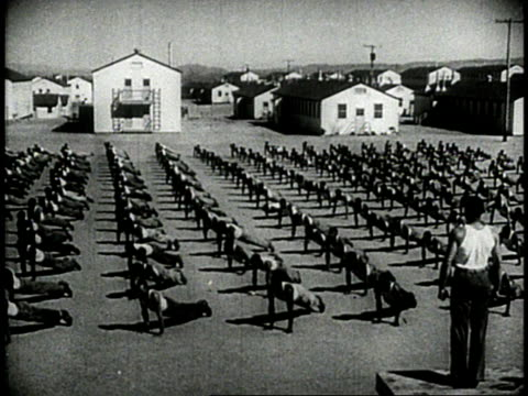 soldiers doing push ups / soldiers bending down / soldiers squatting - 1944 stock-videos und b-roll-filmmaterial