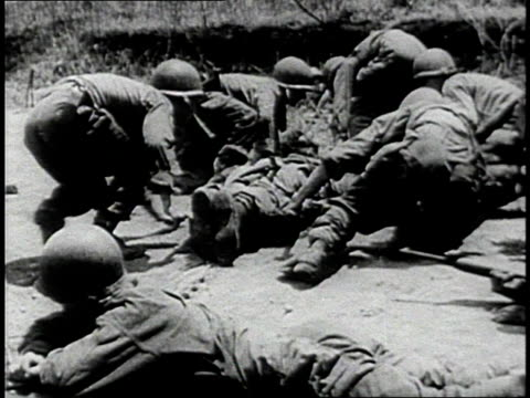 soldiers dragging a wounded soldier on stretcher beneath enemy fire / south korea - korean war stock videos & royalty-free footage
