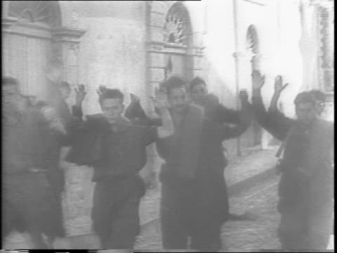 soldiers drink wine from pitcher / italian and some german prisoners walk with their hands up man walking behind with pistol / nazi insignias are... - arrendersi video stock e b–roll