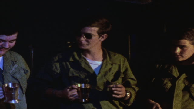 zo soldiers drinking and socializing in club / da nang vietnam - ダナン点の映像素材/bロール