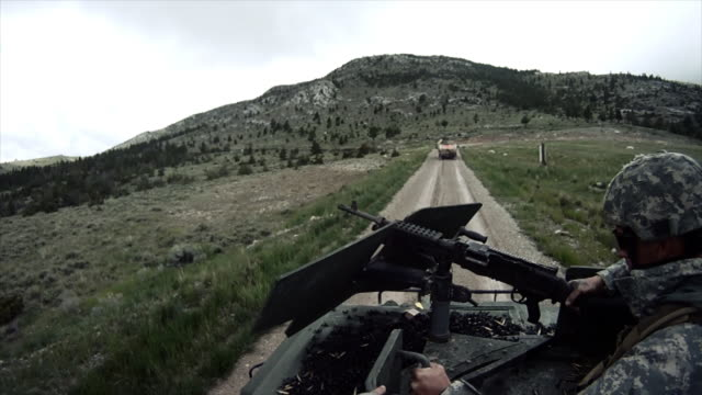 soldiers driving in a convoy - convoy stock videos and b-roll footage