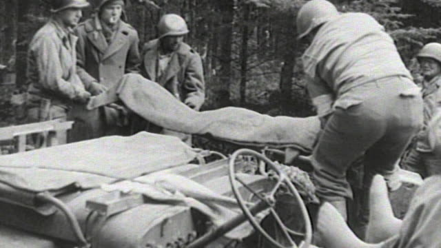 soldiers driving jeeps transporting wounded soldiers in litter cases and unloading injured soldiers at medical aid station and german casualties... - stretcher stock videos and b-roll footage