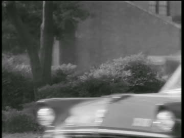 soldiers driving off-road vehicle + car carrying black students to school / little rock, arkansas - 1957 stock videos & royalty-free footage