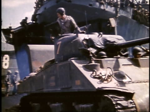 soldiers driving tanks off a ship / iwo jima japan - battle of iwo jima stock videos and b-roll footage