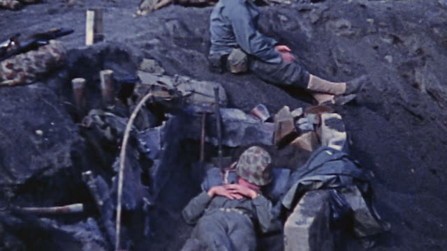 soldiers during world war ii making camp digging foxholes and positions napping and checking radio equipment - campo militare video stock e b–roll