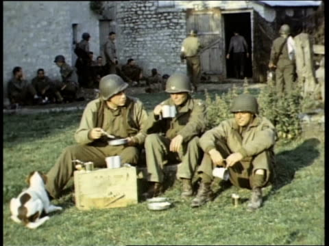 montage soldiers eating and relaxing after dday invasion / france - d day stock videos & royalty-free footage