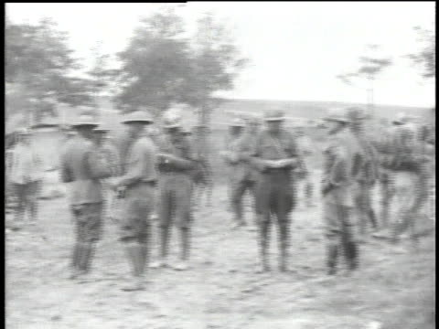 WWI soldiers eating rations in field