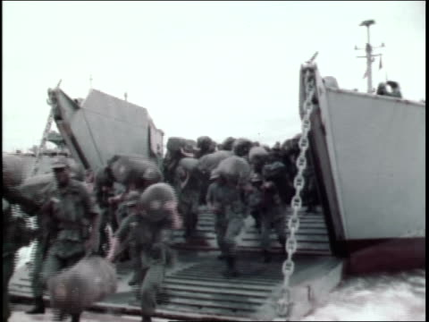 soldiers emerging from a landing craft / soldiers carrying duffel bags and equipment - us military stock videos & royalty-free footage
