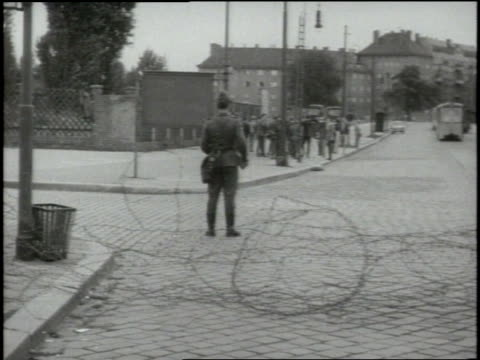 soldiers erect barbed wire fences to divide east and west berlin. - east stock videos & royalty-free footage