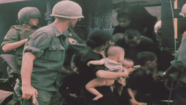 soldiers evacuating villagers onto trucks / vietnam - us military stock videos & royalty-free footage