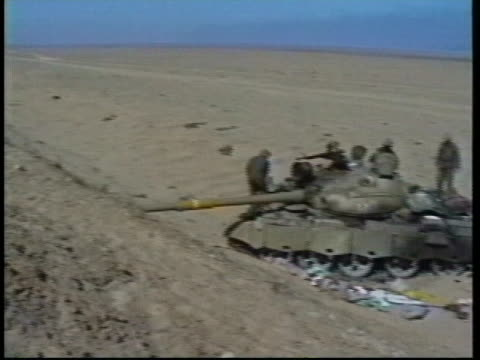 soldiers examine a damaged tank during operation desert storm. - iraq stock videos & royalty-free footage