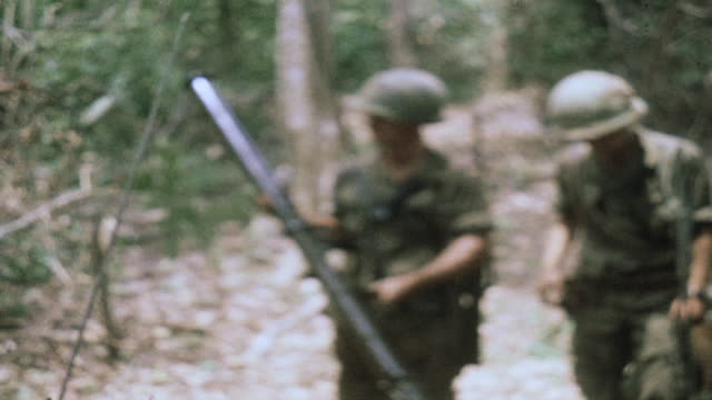 soldiers examining captured chinese rocket launcher in the jungle / vietnam - rocket launcher stock videos & royalty-free footage