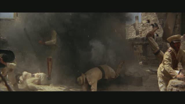 vídeos y material grabado en eventos de stock de slo mo ms soldiers falling in explosion in ruins - western usa