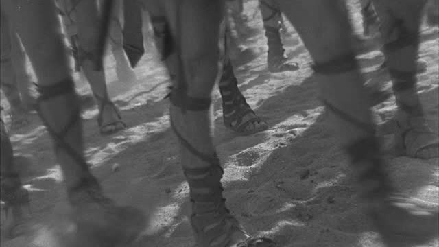 soldiers feet march through the sand. - army soldier stock videos & royalty-free footage