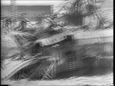 soldiers fighting fires outside bombed building / smoke coming out of destroyed building / car driving over rough terrain in bombed area / montage of... - military attack stock videos and b-roll footage