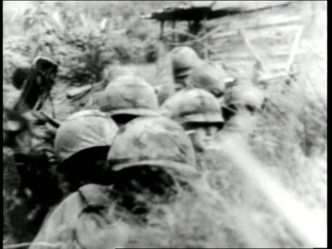 us soldiers fire cannons hide in trenches and run across battlefields during the vietnam war - vietnam war stock videos & royalty-free footage