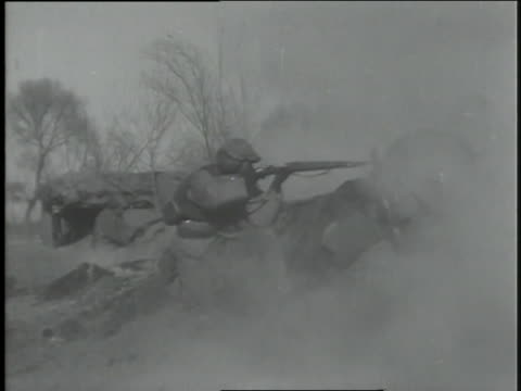 soldiers fire light artillery as infantrymen advance with bayonets affixed. - infantry stock videos & royalty-free footage