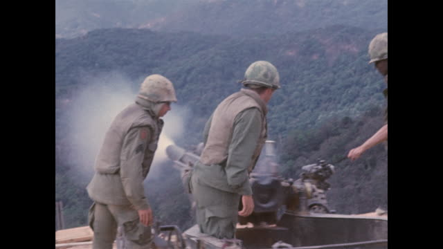 soldiers fire round after round at nearby north vietnamese soldiers who were surrounding the base and hoping to overrun it - vietnam war stock videos & royalty-free footage