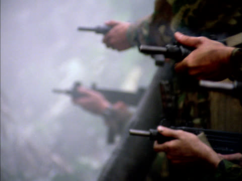 soldiers fire uzis and then make a charge. - machine gun stock videos & royalty-free footage