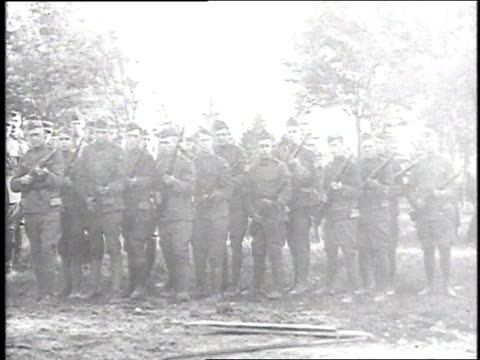 ws soldiers firing a 21gun salute at military funeral then a bugler blowing / france - 1918 stock videos and b-roll footage